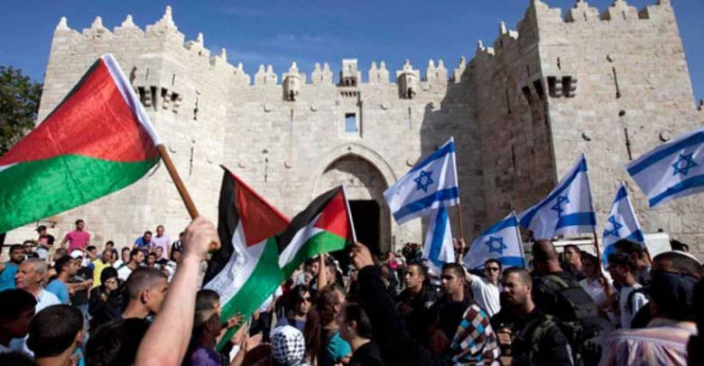 Israeli and Palestinian flags in Jerusalem